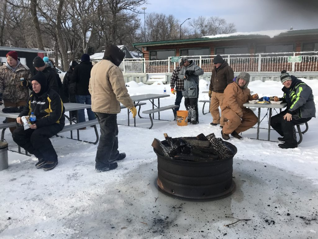 Anglers enjoying the fire pit and lunch