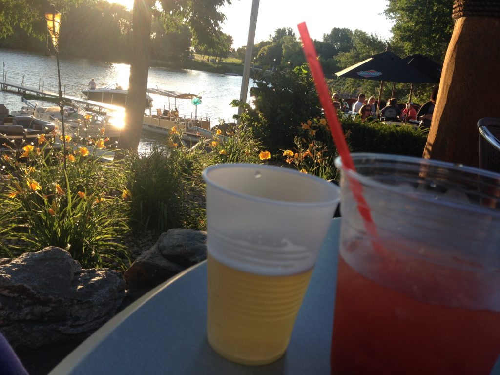 Drinks on the patio and flowers, on the shore of Lake Sisseton at The Marina Lodge in Fairmont, Minnesota